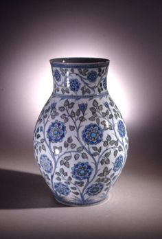 Vase. 'Jacobethan' rose branches between cable bands.Illegible ink inscription on base. Made of grey, turquoise, cobalt painted and glazed ceramic, pottery. 315mm, 16thC, Iznik, Turkey, Ottoman dynasty