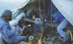 The canvas tent rigged between the masts provides shelter on An Durzunel, a replica fishing lugger in Brittany.  The open fire on the exposed ballast stones is perhaps a little too authentic. DO NOT TRY THIS AT HOME.