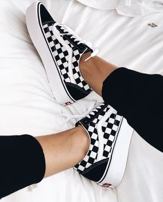Love those black and white checked sneakers.