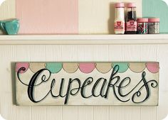 Cupcake wall decor. I can make this! I need to find that pin that shows how to put decals onto wood...