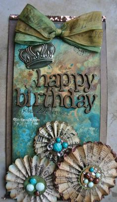 "Tag: ""happy birthday"". paper medalions, ribbon, aqua, brown tones. crown."