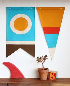 would love this cool twist on nautical flags in a nursery