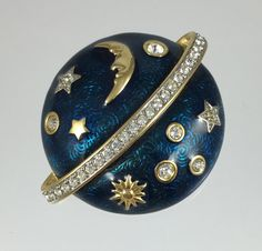 This striking vintage Swarovski retired Celestial brooch is breathtaking in its attention to detail and high quality. Designed as a ringed planet