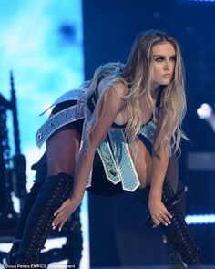 Thigh's the limit: Perrie's ensemble was completed with lace-up boots...