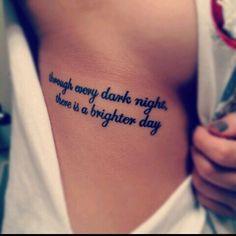 Text tattoo rib