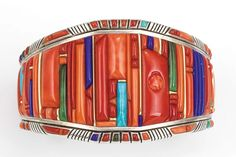 Glittering World: Navajo Jewelry of the Yazzie Family Photo: Raymond C. Yazzie, Silver inlaid with coral, turquoise, lapis lazuli, gold accents. x Collection of Mark and Martha Alexander. 13 in New York