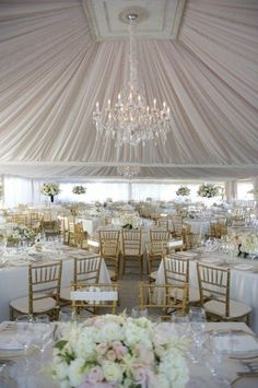 drapery, lighting and gold chavari chairs! Yum