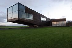 Utriai Residence by G.Natkevicius & Partners. Looks like a whale building eating cars...