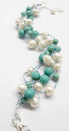 Pearl and turquoise bracelet strung on silk.  So happy.