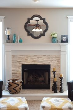 Vintage Wall Mirror Above Stone Fireplace Designs With White Mantel Piece Near Candle Handels