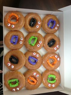 Easy bake sale idea! These flew off the table tonight. Glazed donuts, plastic teeth, frosting eyes