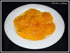 Carpaccio De Naranja con Aceite de oliva, Miel y Sal Marina.