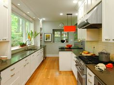 Delightful Contemporary Galley Kitchen Design Ideas With White Kitchen Cabinet Along Drawer And Dark Brown Countertop And Black Cook Top Plus Red Pendant Lamp And Glass Window Also Laminate Wooden Floor With Kitchen Renovation Pictures Also Galley Style Kitchen Designs of Ideas Charming Galley Kitchen Designs from Kitchen Ideas