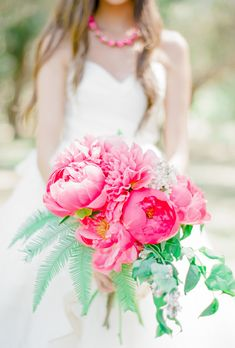 A bold pink peony bouquet is fit for a boho summer wedding