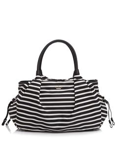 kate spade new york gives the new parent exactly what she wants (and needs): a diaper bag that's as chic as it is practical. This striped carryall boasts pockets for the essentials, a removable changi