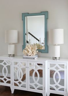 Jana Bek Design - entrances/foyers - teal mirror, white mirrored cabinet, coral accent