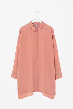 Designed to fall loosely on the body, this long shirt is made from lightweight, fluid fabric with a subtle sheer quality. An oversized fit, it has a hidden front button fastening, dropped shoulder seams and a graduated curved hemline.