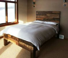 Nice home decor on a budget. Pallet bed frame. Love the head board