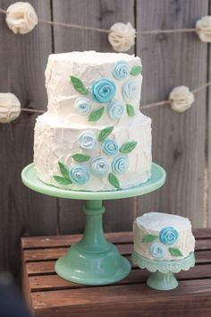 Maybe something like this but I don't like those flowers.  I do like the two tiers with the one little cake and I like the look of the frosting.