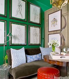 Emerald Paint and big black/white frames breaking it up