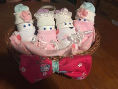 4 cute diaper babies in a basket Made by our youngest crafter age 5 made with Diapers socks washcloths 4 oz bottle recieving blanket and a onsie bow packaged ready to gift