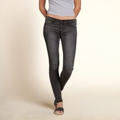 Girls Hollister Jean Leggings | Dark gray wash with fading throughout, faux front pockets and iconic back pocket stitching | HollisterCo.com