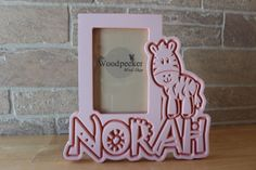 www.woodpeckerwoodshop.etsy.com Personalize this safari themed zebra picture frame for the favorite kid in your life!  Search on Etsy for WoodpeckerWoodShop for 100+ personalized children's frames - choose your name, colors and theme!