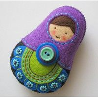 folk matryoshkas-love the embroidery on the felt, double button and bead work