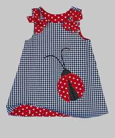 This jaunty jumper comes with gorgeous gingham, a darling ladybug appliqué and bow-embellished buttons at the front.