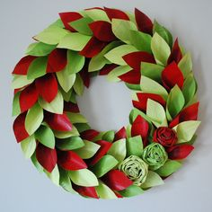 Paper Christmas Wreath. Handmade Christmas wreaths are the best. Find inspiration at Hobbycraft http://www.hobbycraft.co.uk/ #christmas #wreaths #christmaswreaths