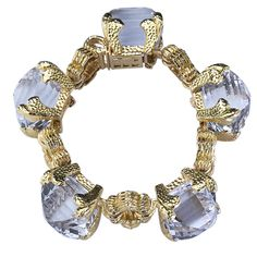 DAVID WEBB A heavy linked bracelet in 18k yellow gold containing five large faceted crystals by David Webb.USA 20th Century