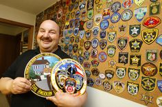 A display of police patches collected by Bill Spitzer, Winona County deputy and St. Charles mayor. (Part of a larger collection of police patches.)