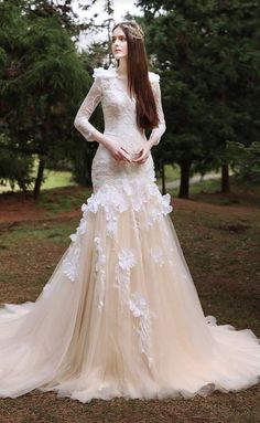 Uniquely glamorous champagne colored wedding dress with tulle skirt; Featured Dress: TIGLILY                                                                                                                                                                                 More