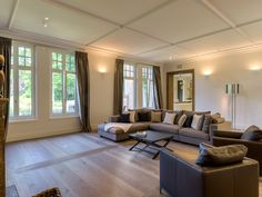 This luminous living room comes with a beautiful parquet floor and italian marble fireplace.