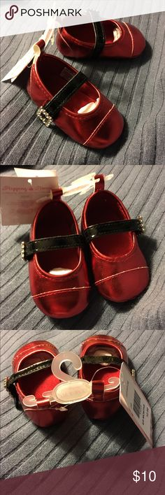 """NWT Stepping Stones Red Santa Mary Jane Shoes 6-9M New with tags Infant Girls red dress shoes are Santa Mary Jane Shoes size 6-9 Months. Shoes are red inside and out with black Velcro straps with """"rhinestones"""" to make the strap look like Santa's belt. Made in China. Stepping Stones Shoes Dress Shoes"""