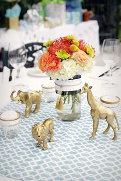 We love this posh safari baby shower! These jungle animals were purchased from a craft store and spray painted gold - love the look.