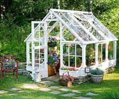 DIY greenhouse made out of old windows and doors by Divonsir Borges