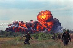 A napalm strike erupts in a fireball near U.S. troops on patrol in South Vietnam in 1966 during the Vietnam War. (AP Photo) #