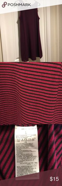 EUC Old Navy Striped Trapeze Dress This dress has been worn once and is in excellent condition. It is a great burgundy and black stripe and the weight of the fabric is perfect. It has a nice stretch and it falls perfectly on. It's great with boots and a cardigan for chilly days or with sandals for the upcoming warmer weather! Old Navy Dresses