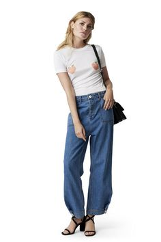 Lightweight denim trousers with large pockets,  ankle buttons and invisible zipper placket.  <br /><br />Model is 175cm tall and wearing a size small/  36.