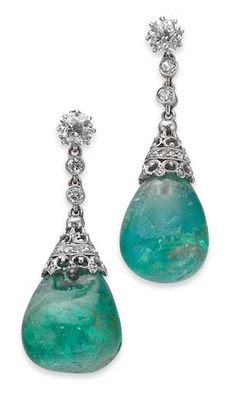 A pair of early 20th century emerald and diamond pendent earrings -  A pair of early 20th century emerald and diamond pendent earrings Each set with an old round brilliant-cut diamond suspending two single-cut diamonds, terminating in an emerald drop to an openwork surmount, set throughout with diamond accents, to post and scroll fittings, length approximately 32mm, the principal diamonds estimated to weigh approximately 0.64ct in total Z