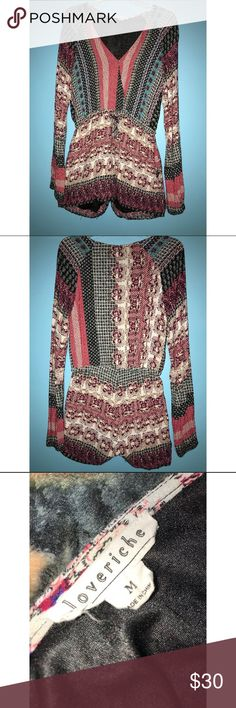 Patterned romper size Medium Red black and blue patterned romper, size Medium. Long sleeve. Has pockets and has only been worn once. Comes from a pet friendly home. Bundle items from my closet and save on shipping! Loveriche Pants Jumpsuits & Rompers