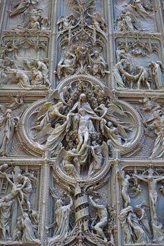 Milan Cathedral, Italy. Famous bronze door sculpture detail.