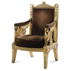 An Imperial carved gilt wood ceremonial armchair designed by Percier and Fontaine, and made by Jacob-Desmalter in 1804.