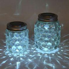 sehr interessante leuchtende gläser mit blauen steinen