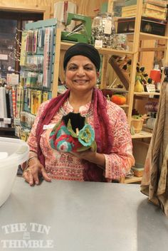 A beautiful, colorful, wet felted vessel being shown off by a Tin Thimble student who made it! #wetfelt #felt #thetinthimble Class Photos & Student Projects - The Tin Thimble
