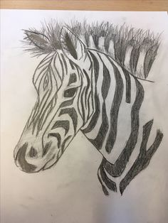 Dit is mijn zebra nu. Eigenlijk ging alles wel prima, ik heb de manen afgemaakt. En wil volgende keer met kleur gaan experimenteren.