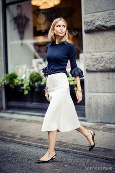 Pernille Teisbaek wears a FWSS sweater; Acne Studios shirt; By Malene Birger skirt, Tabitha Simmons shoes. #TheStreeties