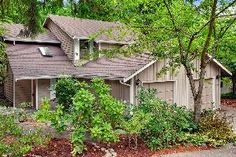 Pristine privacy awaits in this fully remodeled Redmond gem on 2600 sq ft of verdant grounds. Bright, open 1300 sq ft—feel at home on day one! Bay window, 2-story entry & skylights create warm, welcoming space. Spacious rms w/ comforts classic & new. Gleaming hrdwds; dazzling SS apps & granite; cozy FP. Wealth of space in master incl BA & closets. Peaceful deck, trails & nearby park beckon. In esteemed Lake WA school dist. 405 & Eastside a dash away. Relax—previous owners' pride is your gain!