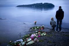 July 2011. Norway. People places candles and flowers near Utøya following the massacre.